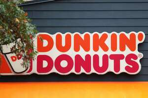 NEW YORK, NEW YORK - OCTOBER 26: A Dunkin' storefront sign is seen on October 26, 2020 in New York City. The Dunkin' Brands, the parent company of the Dunkin' and Baskin Robbins chains, is in negotiations to sell itself to Inspire Brand, a private equity-backed company.  (Photo by Michael M. Santiago/Getty Images)