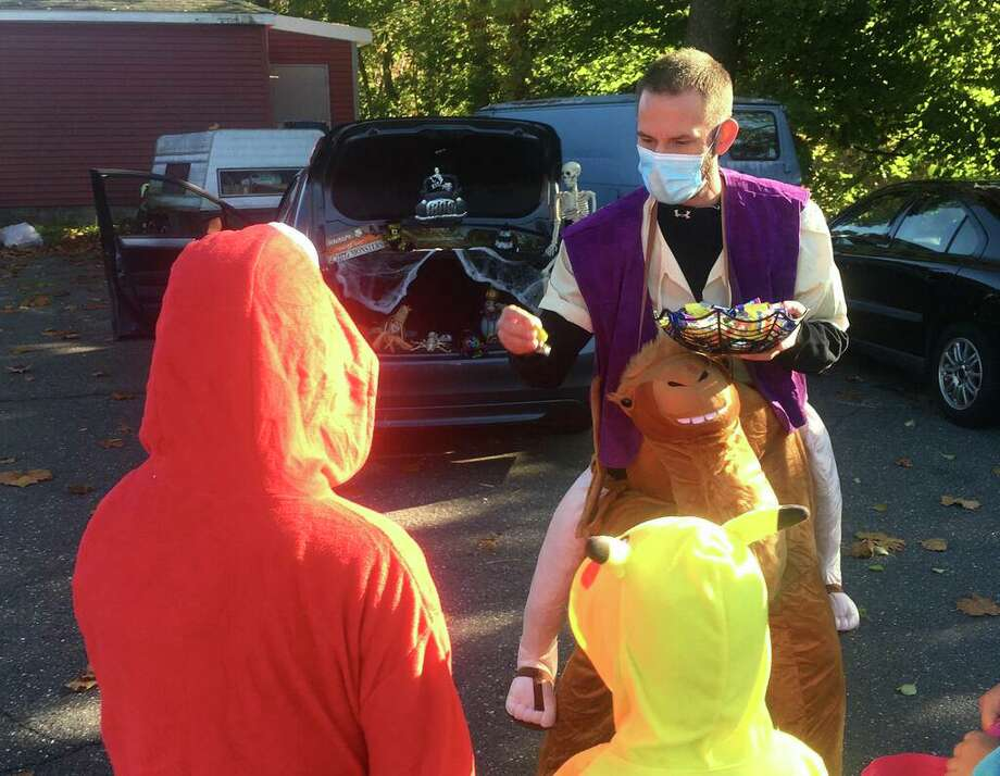 In Beacon Falls, dressed as a camel for his 6-year-old's Halloween trunk-or-treat event, Dan Lapinski talks about the election, as neither a Democrat nor a Republican, who worries about socialism. Three days before the 2020 vote, the Sikorsky helicopter worker said he was excited for it -- and excited for it to be over. Photo: Dan Haar /Hearst Connecticut Media /