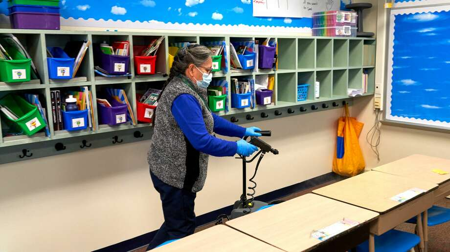Even though Tuesday was a snow day for Midland ISD students, custodial staff – including these at South Elementary School – were at work disinfecting campuses. They were using PURO UV disinfection lights, which not only eradicate COVID-19, but other viruses and bacteria, such as the flu. Each campus will have at least one PURO UV light, which are being used in addition to misters and cleaning by hand. Photo: Courtesy Of Midland ISD