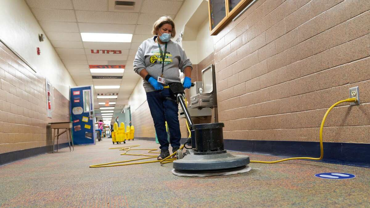 Even though Tuesday was a snow day for Midland ISD students, custodial staff - including these at South Elementary School - were at work disinfecting campuses. They were using PURO UV disinfection lights, which not only eradicate COVID-19, but other viruses and bacteria, such as the flu. Each campus will have at least one PURO UV light, which are being used in addition to misters and cleaning by hand.