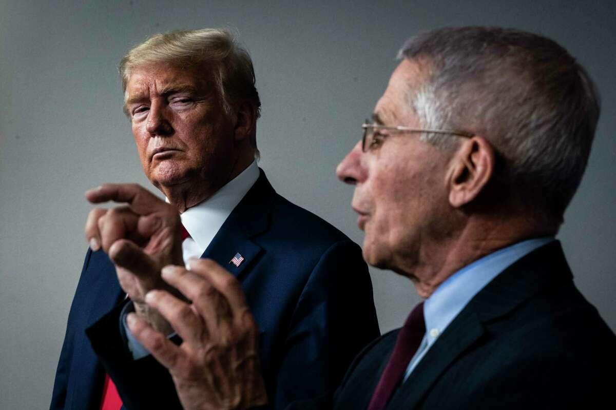 President Donald Trump listens as Dr. Anthony Fauci speaks with members of the coronavirus task force din March.