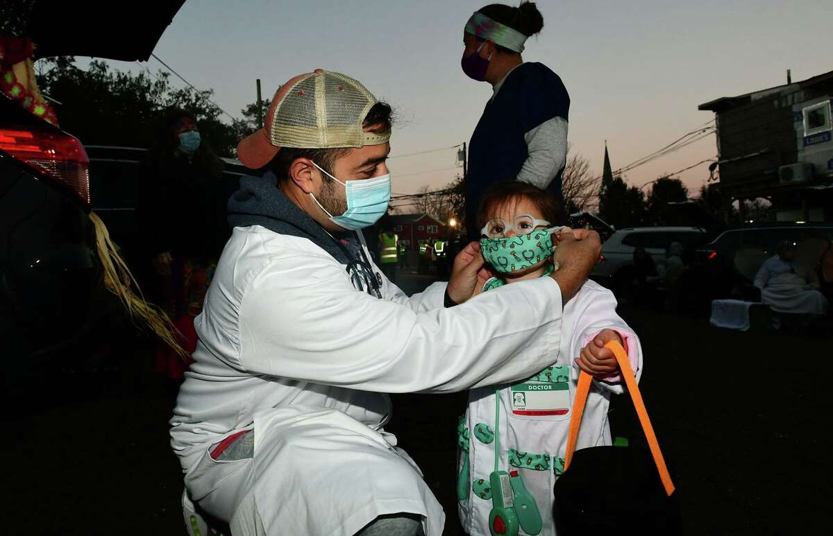 Anthony luciani pu a mask on his daughter Paisley Luciani at the Word Alive Church annual communitywide