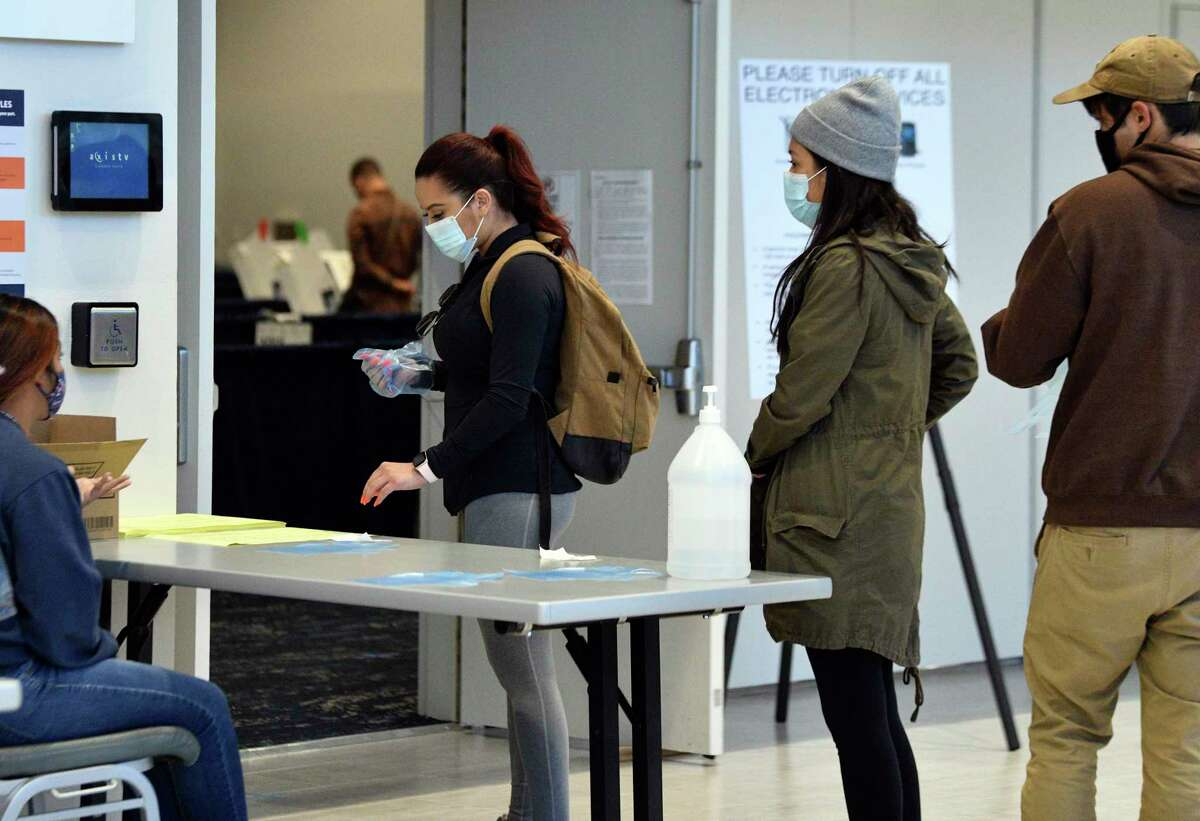 Students prepare to early vote at UTSA on Thursday, Oct. 29, 2020.