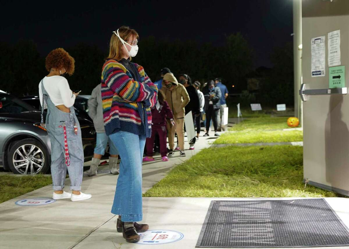 Aubrey Calaway, 23, waits to vote outside Victory Houston polling station in Houston on Friday, Oct. 30, 2020. The location was one of the Harris County's 24-hour locations.