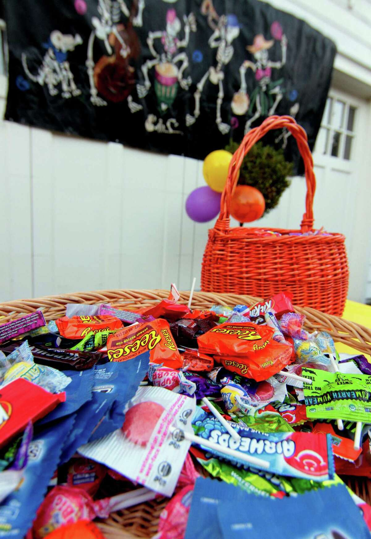 Candy sits out for trick or treaters in Rowayton, Conn., on Saturday Oct. 31, 2020.