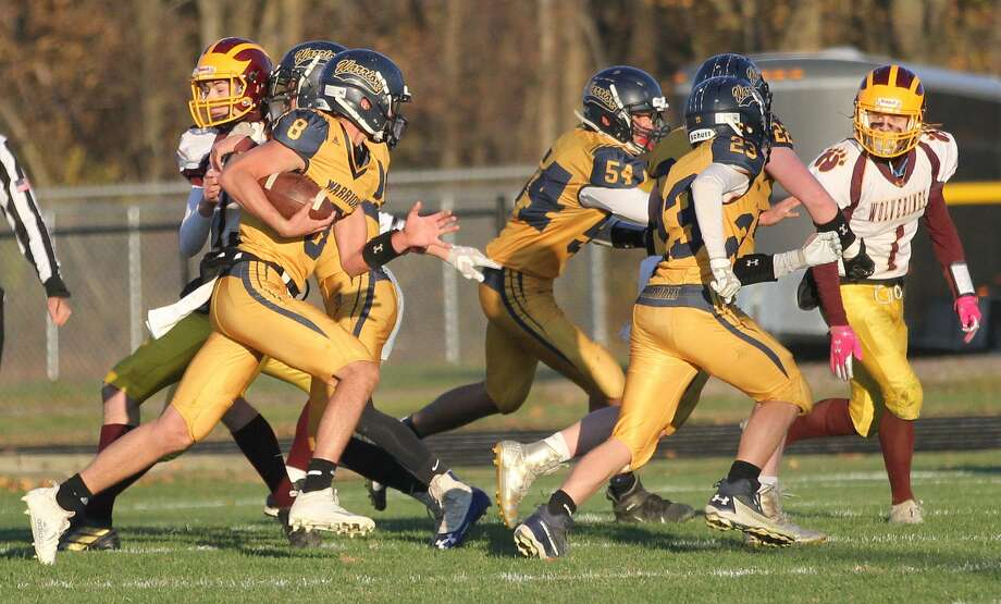 The North Huron Warriors rolled over the Au Gres-Sims Wolverines on Saturday, 66-18, to open the MHSAA playoffs. Photo: Mark Birdsall/Huron Daily Tribune