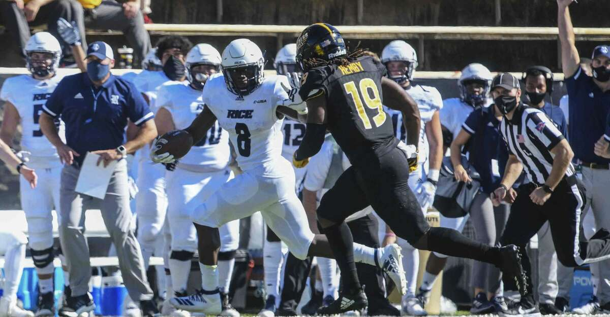 Rice running back Juma Otoviano fends off Southern Mississippi defensive back Ky'el Hemby during an NCAA college football game in Hattiesburg, Miss., Saturday, Oct. 31, 2020. (Cam Bonelli/Hattiesburg American via AP)
