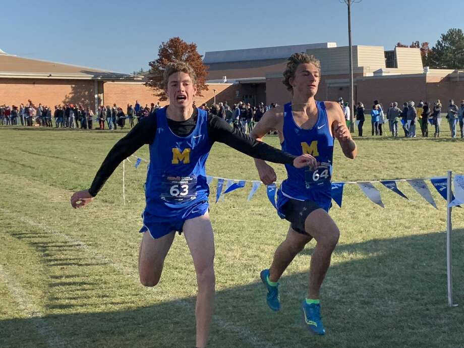 Midland High's Joshua Maschino (left) and Joey Pelletier compete in the Division 1 cross country regional held at White Pine Middle School on Saturday, Oct. 31, 2020. Photo: Fred Kelly/fred.kelly@mdn.net