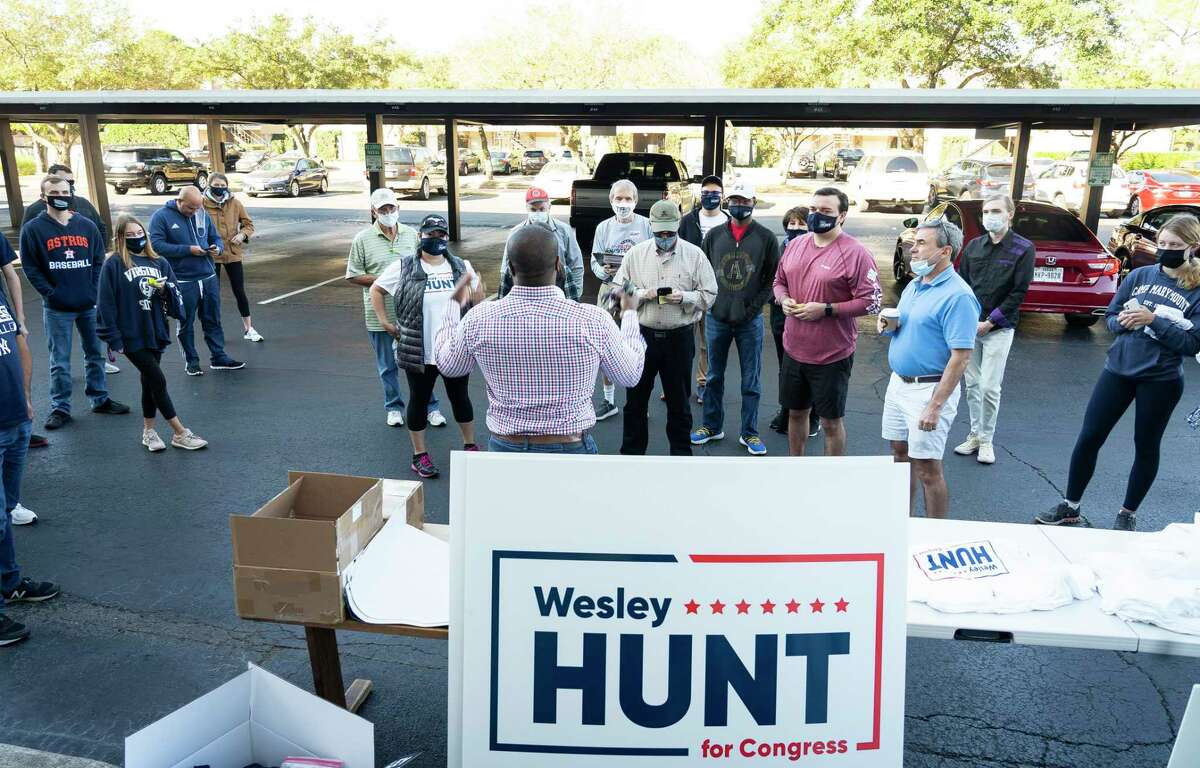 Republican congressional candidate Wesley Hunt speaks with volunteers before the volunteers head out to block walk from the campaign's west Houston headquarters, Saturday, Oct. 31, 2020.