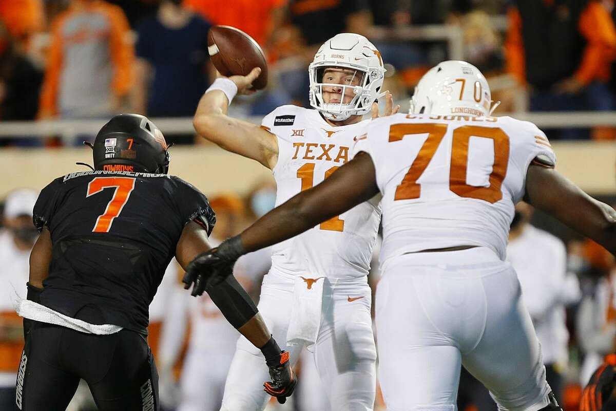 STILLWATER, OK - OCTOBER 31: Quarterback Sam Ehlinger #11 of the Texas Longhorns throws the ball under pressure from linebacker Amen Ogbongbemiga #7 in overtime at Boone Pickens Stadium on October 31, 2020 in Stillwater, Oklahoma. Texas won 41-34. (Photo by Brian Bahr/Getty Images)