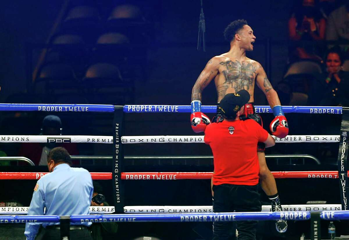 Regis Prograis celebrates his win over Juan Heraldez during the third round of their super lightweight boxing bout Saturday, Oct. 31, 2020, in San Antonio. (AP Photo/Ronald Cortes)