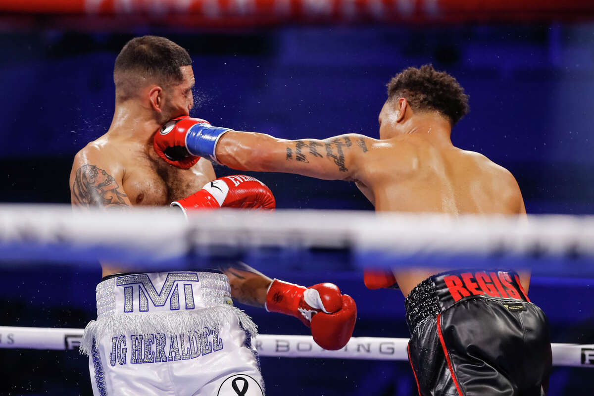 Regis Prograis lands a left hand on Juan Heraldez in their fight Saturday, Oct. 31, 2020 at San Antonio's Alamodome.
