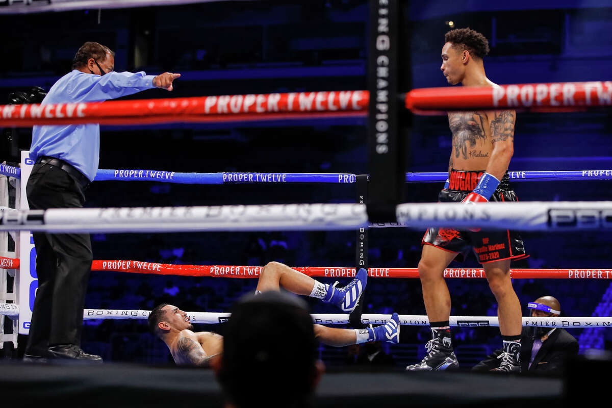 Regis Prograis stands over a fallen Juan Heraldez in the third round of their fight Saturday, Oct. 31, 2020 at San Antonio's Alamodome.