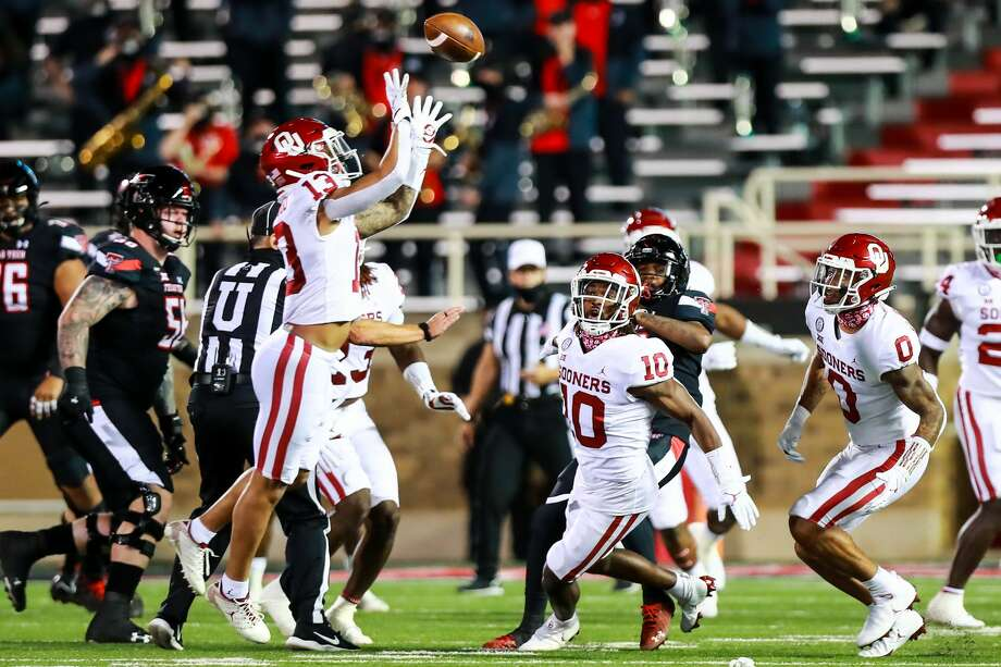 LUBBOCK, TEXAS - OCTOBER 31: Safety Tre Norwood #13 of the Oklahoma Sooners intercepts a tipped pass during the first half of the college football game against the Texas Tech Red Raiders at Jones AT&T Stadium on October 31, 2020 in Lubbock, Texas. (Photo by John E. Moore III/Getty Images) Photo: John E. Moore III/Getty Images / 2020 Getty Images