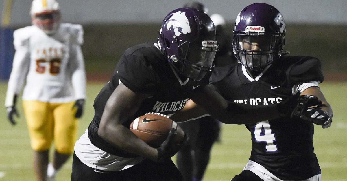 Wheatley running back Darnell Buchanan, left, runs for a touchdown as Kei'Juan Hatter gets out of the way during the second half of a high school football game against Yates, Saturday, Oct. 31, 2020, in Houston.