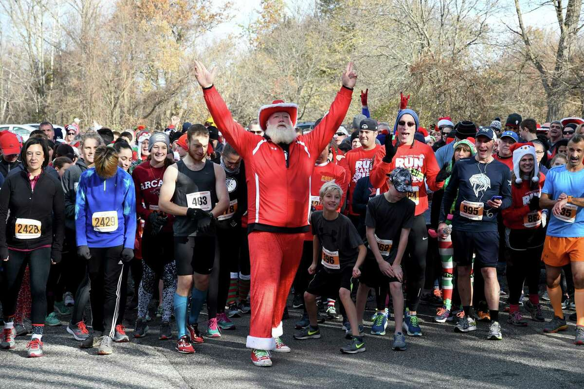 Bill Buckbee, aka Santa, gets the field ready for the start of the Run Santa Run 5k Run, Walk and Kids Fun Run at Harrybrooke Park in New Milford in 2017. This year's event will be held at the park and virtually Nov. 28.
