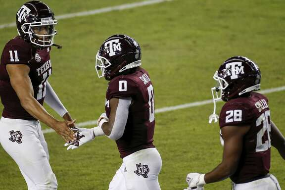 Kellen Mond #11 of the Texas A&M Aggies congratulates Ainias Smith #0 after a touchdown in the first quarter against the Arkansas Razorbacks at Kyle Field on October 31, 2020 in College Station, Texas. (Photo by Tim Warner/Getty Images)