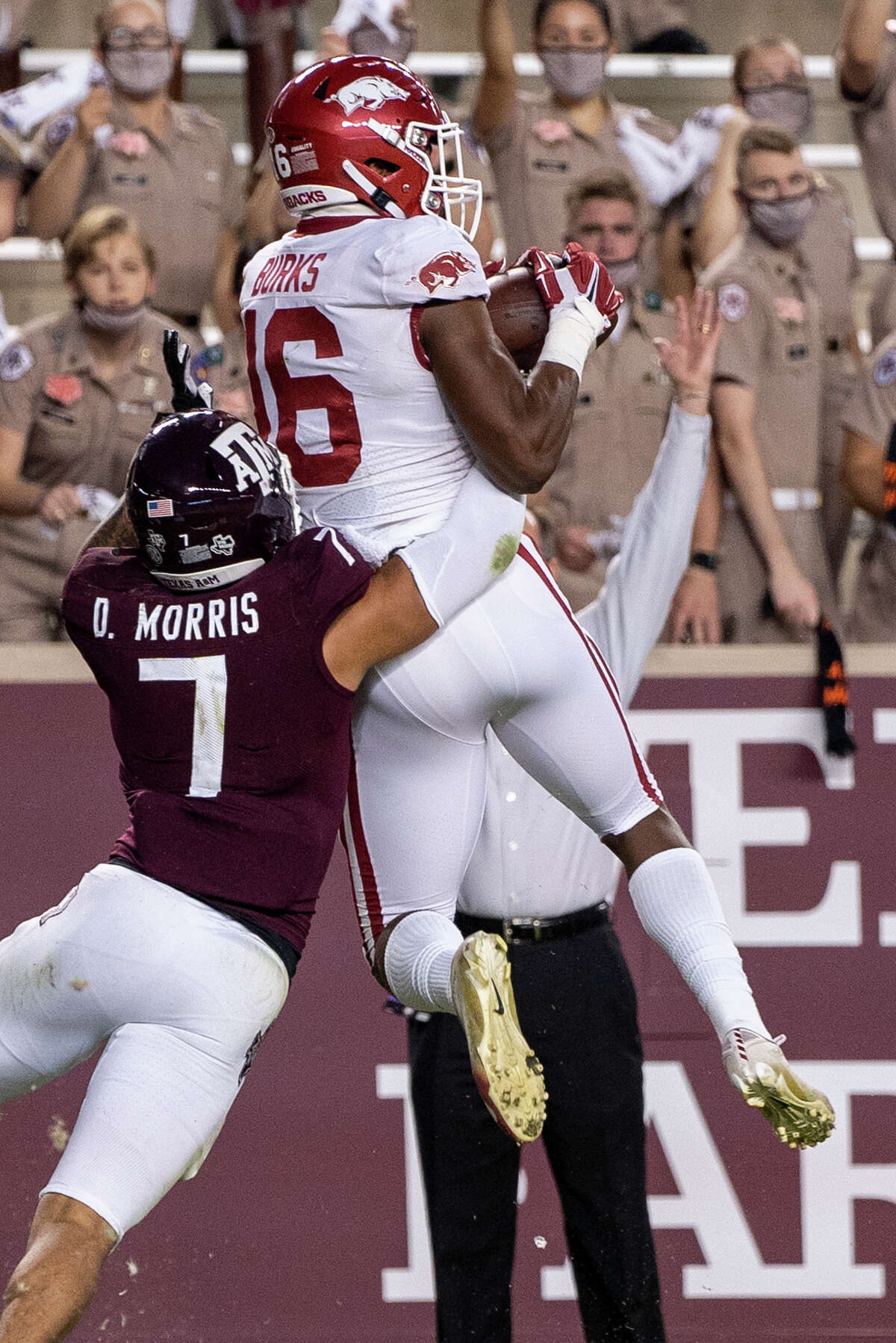 Arkansas wide receiver Treylon Burks (16) catches a pass for a touchdown while Texas A&M defensive back Devin Morris (7) defends during the first quarter of an NCAA college football game Saturday, Oct. 31, 2020, in College Station, Texas. (AP Photo/Sam Craft)