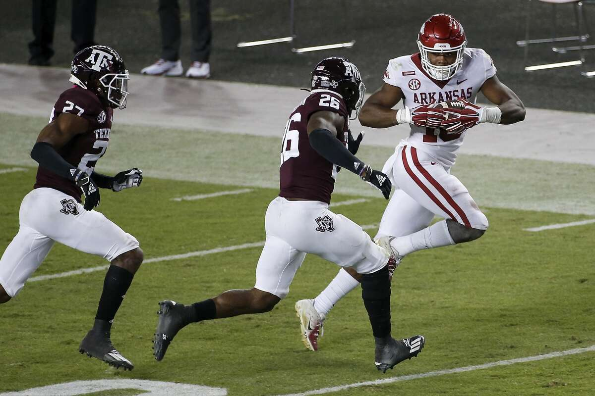 COLLEGE STATION, TEXAS - OCTOBER 31: Treylon Burks #16 of the Arkansas Razorbacks runs after a reception in the second quarter defended by Demani Richardson #26 of the Texas A&M Aggies at Kyle Field on October 31, 2020 in College Station, Texas. (Photo by Tim Warner/Getty Images)