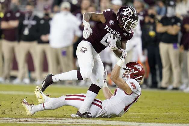 Texas A&M running back Ainias Smith (0) is tackled by Arkansas defensive back Hudson Clark (17) after knocking Clark over during a run in the second half of an NCAA college football game, Saturday, Oct. 31, 2020, in College Station, Texas. (AP Photo/Sam Craft) Photo: Sam Craft/Associated Press / Copyright 2020 The Associated Press. All rights reserved.