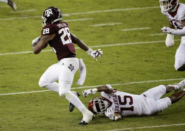 COLLEGE STATION, TEXAS - OCTOBER 31: Isaiah Spiller #28 of the Texas A&M Aggies breaks a tackle by Simeon Blair #15 of the Arkansas Razorbacks in the second quarter at Kyle Field on October 31, 2020 in College Station, Texas. (Photo by Tim Warner/Getty Images) Photo: Tim Warner/Getty Images / 2020 Getty Images