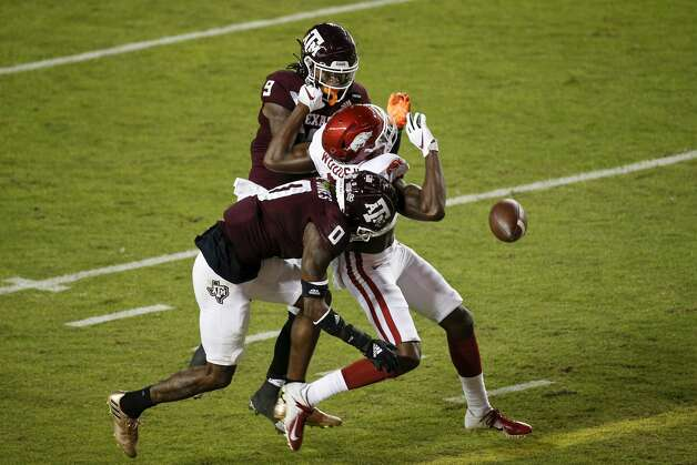 COLLEGE STATION, TEXAS - OCTOBER 31: Leon O'Neal Jr. #9 and Myles Jones #0 of the Texas A&M Aggies break up a pass intended for Mike Woods #8 of the Arkansas Razorbacks in the third quarter at Kyle Field on October 31, 2020 in College Station, Texas. (Photo by Tim Warner/Getty Images) Photo: Tim Warner/Getty Images / 2020 Getty Images