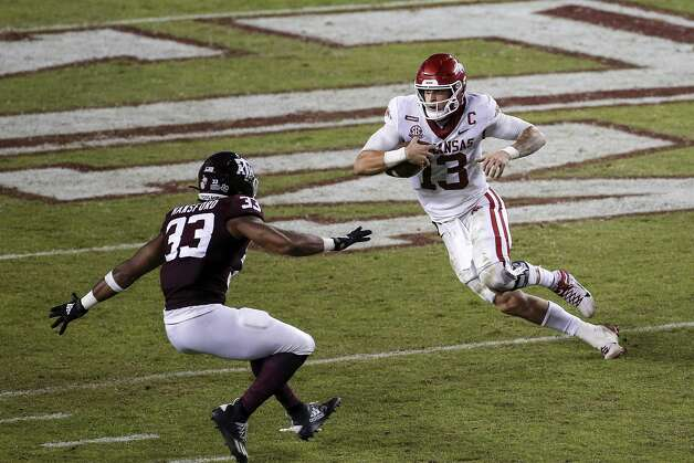 COLLEGE STATION, TEXAS - OCTOBER 31: Feleipe Franks #13 of the Arkansas Razorbacks runs the ball against Aaron Hansford #33 of the Texas A&M Aggies in the third quarter at Kyle Field on October 31, 2020 in College Station, Texas. (Photo by Tim Warner/Getty Images) Photo: Tim Warner/Getty Images / 2020 Getty Images
