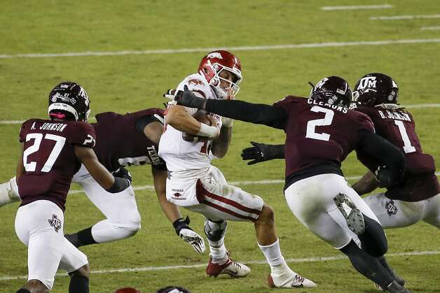 COLLEGE STATION, TEXAS - OCTOBER 31: Feleipe Franks #13 of the Arkansas Razorbacks is sacked by DeMarvin Leal #8 and Micheal Clemons #2 of the Texas A&M Aggies in the third quarter at Kyle Field on October 31, 2020 in College Station, Texas. (Photo by Tim Warner/Getty Images) Photo: Tim Warner/Getty Images / 2020 Getty Images
