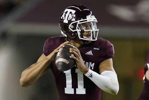 Texas A&M quarterback Kellen Mond (11) looks downfield to pass against Arkansas during the second half of an NCAA college football game, Saturday, Oct. 31, 2020, in College Station, Texas. (AP Photo/Sam Craft) Photo: Sam Craft/Associated Press / Copyright 2020 The Associated Press. All rights reserved.
