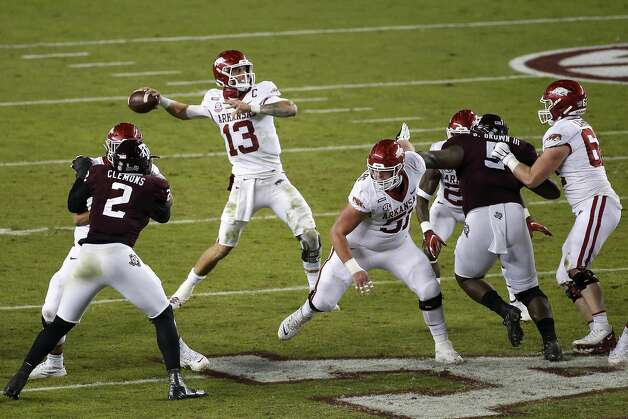 COLLEGE STATION, TEXAS - OCTOBER 31: Feleipe Franks #13 of the Arkansas Razorbacks drops back to pass in the second quarter against the Texas A&M Aggies at Kyle Field on October 31, 2020 in College Station, Texas. (Photo by Tim Warner/Getty Images) Photo: Tim Warner/Getty Images / 2020 Getty Images