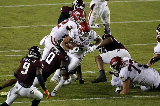 COLLEGE STATION, TEXAS - OCTOBER 31: Rakeem Boyd #5 of the Arkansas Razorbacks is tackled by Myles Jones #0 of the Texas A&M Aggies in the third quarter at Kyle Field on October 31, 2020 in College Station, Texas. (Photo by Tim Warner/Getty Images) Photo: Tim Warner/Getty Images / 2020 Getty Images