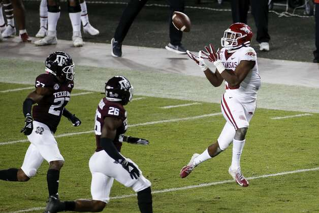 COLLEGE STATION, TEXAS - OCTOBER 31: Treylon Burks #16 of the Arkansas Razorbacks catches a pass in the second quarter against the Texas A&M Aggies at Kyle Field on October 31, 2020 in College Station, Texas. (Photo by Tim Warner/Getty Images) Photo: Tim Warner/Getty Images / 2020 Getty Images