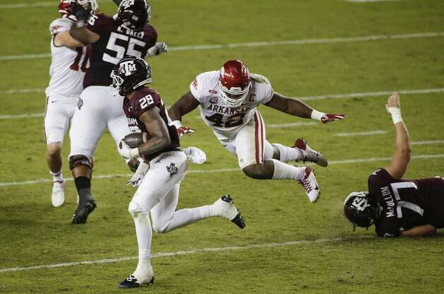 COLLEGE STATION, TEXAS - OCTOBER 31: Isaiah Spiller #28 of the Texas A&M Aggies runs past Jonathan Marshall #42 of the Arkansas Razorbacks in the second quarter at Kyle Field on October 31, 2020 in College Station, Texas. (Photo by Tim Warner/Getty Images) Photo: Tim Warner/Getty Images / 2020 Getty Images