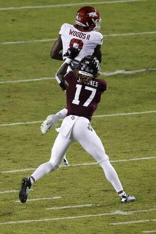 COLLEGE STATION, TEXAS - OCTOBER 31: Mike Woods #8 of the Arkansas Razorbacks catches a pass defended by Jaylon Jones #17 of the Texas A&M Aggies in the second quarter at Kyle Field on October 31, 2020 in College Station, Texas. (Photo by Tim Warner/Getty Images) Photo: Tim Warner/Getty Images / 2020 Getty Images