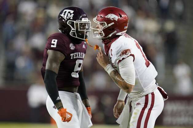 Texas A&M defensive back Leon O'Neal Jr. (9) reacts after tackling Arkansas quarterback Feleipe Franks (13) during the first quarter of an NCAA college football game Saturday, Oct. 31, 2020, in College Station, Texas. (AP Photo/Sam Craft) Photo: Sam Craft/Associated Press / Copyright 2020 The Associated Press. All rights reserved.