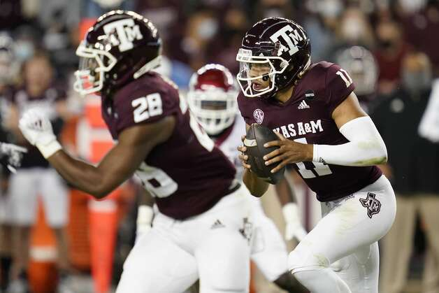 Texas A&M quarterback Kellen Mond (11) rushes against Arkansas during the first quarter of an NCAA college football game Saturday, Oct. 31, 2020, in College Station, Texas. (AP Photo/Sam Craft) Photo: Sam Craft/Associated Press / Copyright 2020 The Associated Press. All rights reserved.