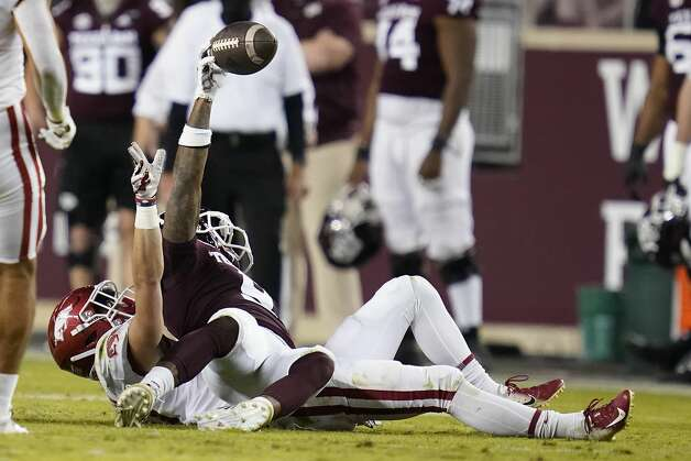 Texas A&M wide receiver Hezekiah Jones (9) reacts after a catch, and being tackled by Arkansas defensive back Hudson Clark (17) during the second quarter of an NCAA college football game Saturday, Oct. 31, 2020, in College Station, Texas. (AP Photo/Sam Craft) Photo: Sam Craft/Associated Press / Copyright 2020 The Associated Press. All rights reserved.