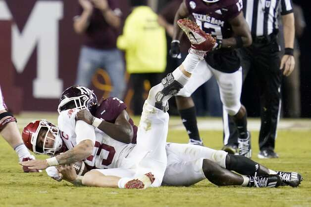 Texas A&M defensive lineman Tyree Johnson (3) sacks Arkansas quarterback Feleipe Franks (13) for a loss during the second quarter of an NCAA college football game Saturday, Oct. 31, 2020, in College Station, Texas. (AP Photo/Sam Craft) Photo: Sam Craft/Associated Press / Copyright 2020 The Associated Press. All rights reserved.