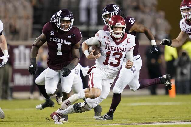 Arkansas quarterback Feleipe Franks (13) rushes for a first down against Texas A&M during the first quarter of an NCAA college football game Saturday, Oct. 31, 2020, in College Station, Texas. (AP Photo/Sam Craft) Photo: Sam Craft/Associated Press / Copyright 2020 The Associated Press. All rights reserved.