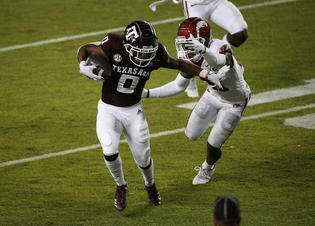 COLLEGE STATION, TEXAS - OCTOBER 31: Ainias Smith #0 of the Texas A&M Aggies catches a pass for a touchdown against Montaric Brown #21 of the Arkansas Razorbacks in the first quarter at Kyle Field on October 31, 2020 in College Station, Texas. (Photo by Tim Warner/Getty Images) Photo: Tim Warner/Getty Images / 2020 Getty Images