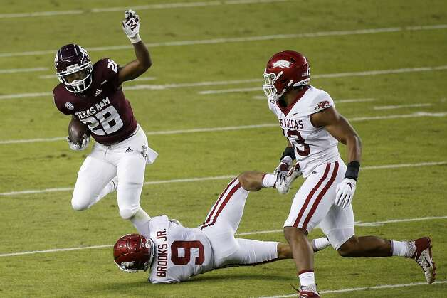COLLEGE STATION, TEXAS - OCTOBER 31: Isaiah Spiller #28 of the Texas A&M Aggies is tackled by Greg Brooks Jr. #9 of the Arkansas Razorbacks in the first quarter at Kyle Field on October 31, 2020 in College Station, Texas. (Photo by Tim Warner/Getty Images) Photo: Tim Warner/Getty Images / 2020 Getty Images
