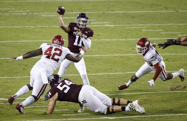 COLLEGE STATION, TEXAS - OCTOBER 31: Kellen Mond #11 of the Texas A&M Aggies throws a pass under pressure by Jonathan Marshall #42 of the Arkansas Razorbacks in the first quarter at Kyle Field on October 31, 2020 in College Station, Texas. (Photo by Tim Warner/Getty Images) Photo: Tim Warner/Getty Images / 2020 Getty Images