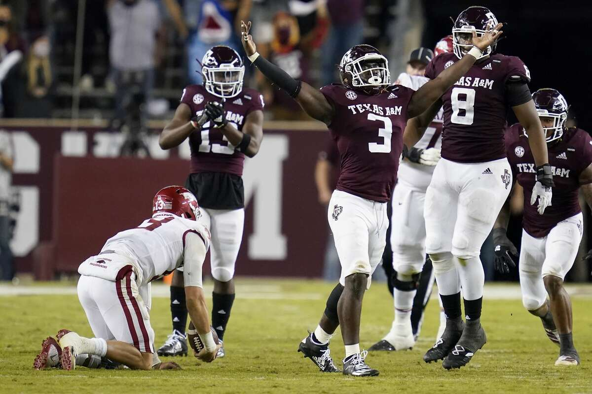 Texas A&M defensive lineman Tyree Johnson (3) reacts after sacking Arkansas quarterback Feleipe Franks (13) during the second quarter of an NCAA college football game, Saturday, Oct. 31, 2020, in College Station, Texas. (AP Photo/Sam Craft)