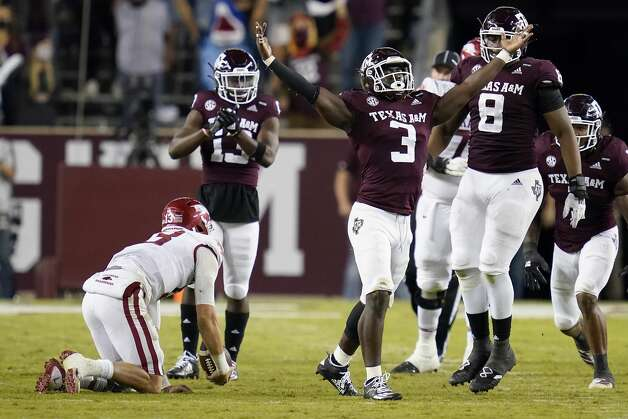 Texas A&M defensive lineman Tyree Johnson (3) reacts after sacking Arkansas quarterback Feleipe Franks (13) during the second quarter of an NCAA college football game, Saturday, Oct. 31, 2020, in College Station, Texas. (AP Photo/Sam Craft) Photo: Sam Craft/Associated Press / Copyright 2020 The Associated Press. All rights reserved.