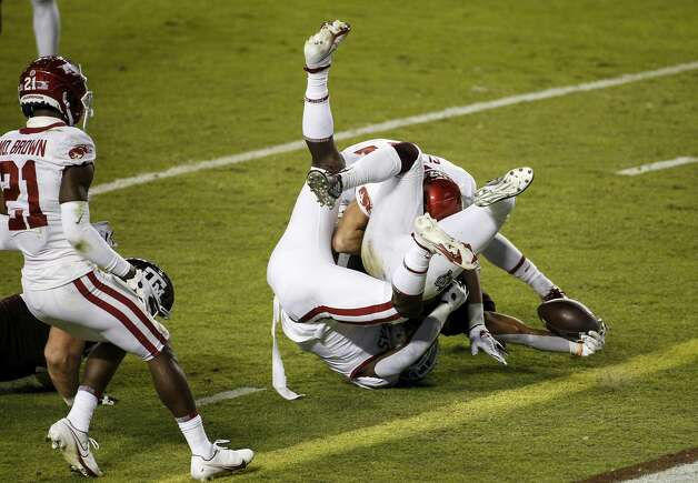 COLLEGE STATION, TEXAS - OCTOBER 31: Ainias Smith #0 of the Texas A&M Aggies extends the ball over the goal line for a touchdown in the first quarter against the Arkansas Razorbacks at Kyle Field on October 31, 2020 in College Station, Texas. (Photo by Tim Warner/Getty Images) Photo: Tim Warner/Getty Images / 2020 Getty Images
