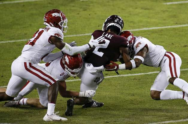 COLLEGE STATION, TEXAS - OCTOBER 31: Chase Lane #2 of the Texas A&M Aggies is hit by Jalen Catalon #1 of the Arkansas Razorbacks in the first quarter at Kyle Field on October 31, 2020 in College Station, Texas. Jalen Catalon #1 was ejected for targeting. (Photo by Tim Warner/Getty Images) Photo: Tim Warner/Getty Images / 2020 Getty Images