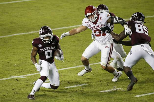 COLLEGE STATION, TEXAS - OCTOBER 31: Ainias Smith #0 of the Texas A&M Aggies rushes for a touchdown in the first quarter while defended by Grant Morgan #31 of the Arkansas Razorbacks at Kyle Field on October 31, 2020 in College Station, Texas. (Photo by Tim Warner/Getty Images) Photo: Tim Warner/Getty Images / 2020 Getty Images