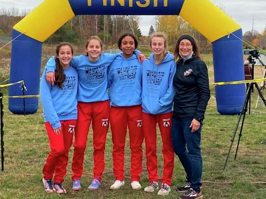 Crossroads' girls cross county team: (from left) Jackie Cole, Kaitlin Buys, Samara Turner, Amelia Thompson and Coach Debe Mitchell. (Courtesy photo)