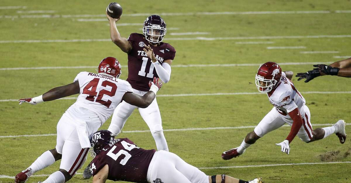 Kellen Mond #11 of the Texas A&M Aggies throws a pass under pressure by Jonathan Marshall #42 of the Arkansas Razorbacks in the first quarter at Kyle Field on October 31, 2020 in College Station, Texas. (Photo by Tim Warner/Getty Images)