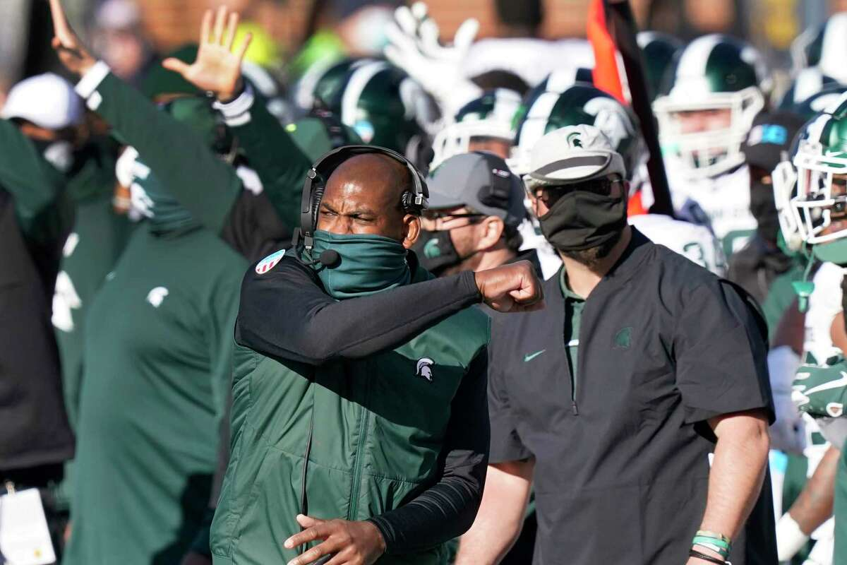 Michigan State head coach Mel Tucker pumps his fist after the team defeated Michigan in an NCAA college football game, Saturday in Ann Arbor, Mich. (AP Photo/Carlos Osorio)
